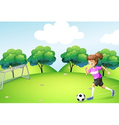 An athletic girl playing soccer vector image