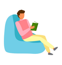 young guy is sitting in chair and reading book vector image