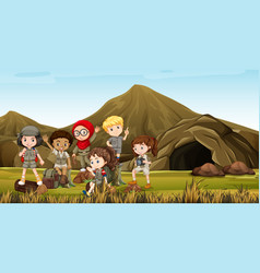 kids in safari costume camping out by the cave vector image