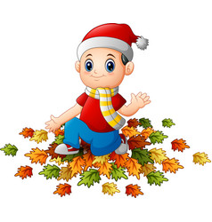little boy wearing santa hat with autumn leaves vector image