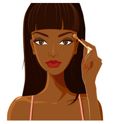 attractive woman with dark skin applying eyeshadow vector image