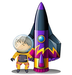 A young astronaut beside the rocket vector image vector image