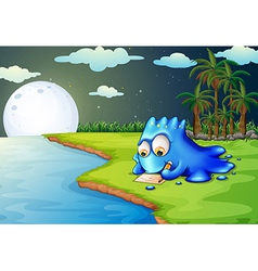 A blue monster writing a letter at the riverbank vector image