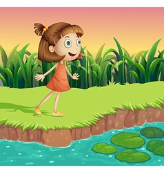 A small girl at the riverbank vector