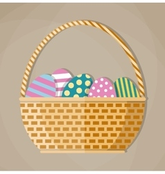 Basket full of colored Easter eggs vector image