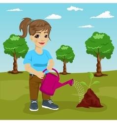 cute littke girl watering a plant in park vector image