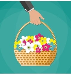 Hand Carrying basket with flowers vector image