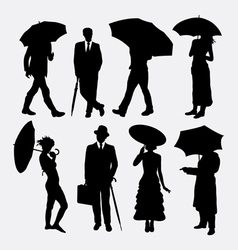 People with umbrella silhouettes vector image vector image