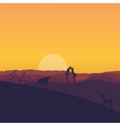silhouette of couple kissing in sunset dramatic vector image