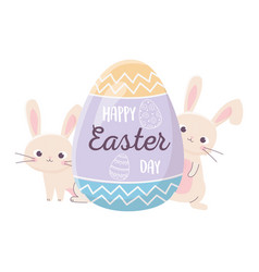 happy easter rabbits with lettering in egg vector image