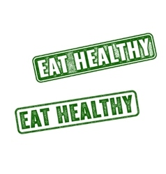 Two green grunge rubber stamps Eat Healthy vector image