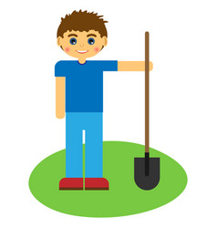 Boy with a shovel on green grass vector