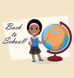 cute african american girl showing on globe vector image