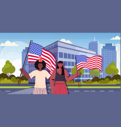 man woman couple holding usa flags celebrating 4th vector image
