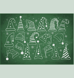 set of christmas hats on blackboard background vector image