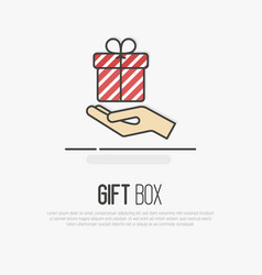 hand holding a striped gift box vector image