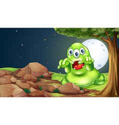 A scary green monster near the rocks under the vector image