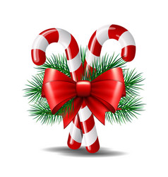 Christmas candy canes with red bow isolated on vector