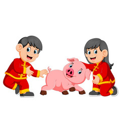 two kids are playing with a little pig vector image