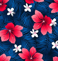 Tropical red hibiscus flowers in a seamless vector image