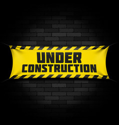 Under construction banner on black vector