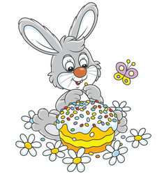 bunny with an easter cake vector image