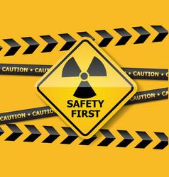 Radiation warning sign on yellow wall vector