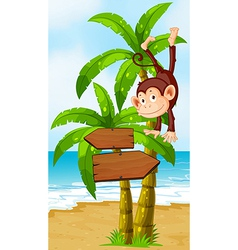A playful monkey at the beach with an arrowboard vector image vector image