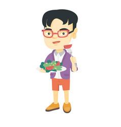 Little asian boy eating vegetable salad vector