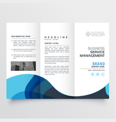 Elegant trifold brochure design with blue wave vector