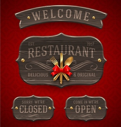 Set of vintage wooden Restaurant signs vector image