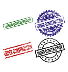 scratched textured under construction stamp seals vector image