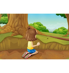 A young girl playing at the ground in the forest vector image