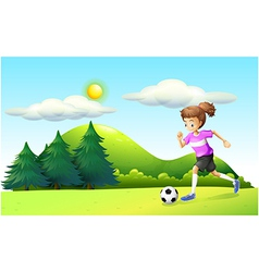 A girl playing soccer vector image