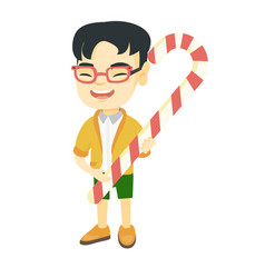 asian little boy holding christmas candy cane vector image