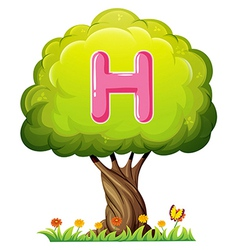 A tree with a letter H vector