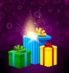 Set of gift boxes with beautiful light coming from vector