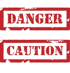 Rubber stamp with text danger and caution vector image