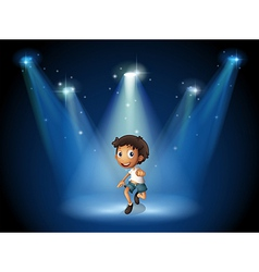 A boy dancing with spotlights vector