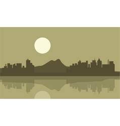 Silhouette of city and mountain backgrounds vector