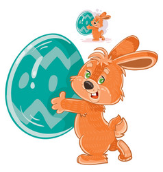 Easter bunny holding a decorated egg in its vector