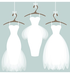 Wedding dresses on hangers vector image