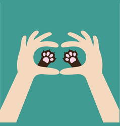two hands holding cute cat dog paw print love and vector image