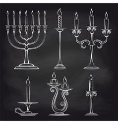 Hand drawn candles set on chalkboard vector