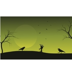 Halloween crow and hand zombie silhouette vector