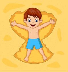 Cartoon boy playing on sands vector