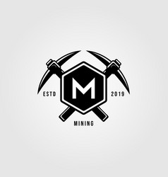 pickaxe crosses over letter m hexagon vintage vector image