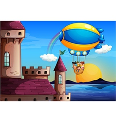 A floating balloon with kids going to the castle vector image