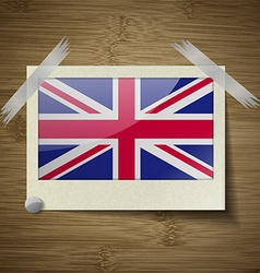 Flags United Kingdom at frame on wooden texture vector image