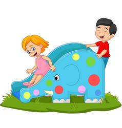 little kids playing on elephant slide vector image